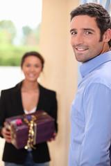 woman receiving gift from boyfriend
