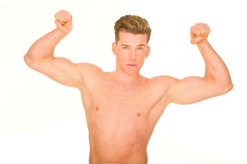 bare-chested man showing muscles