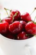 Fresh red cherries in beaker