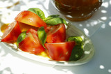 Tomatoes with fresh basil in olive oil