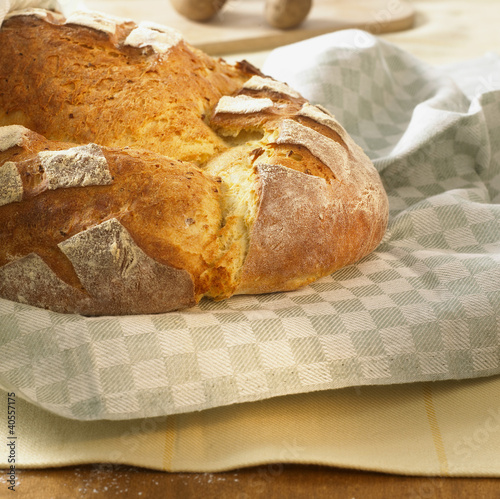 Freshly baked potato bread on tea towel