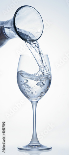 Pouring water into glass from carafe