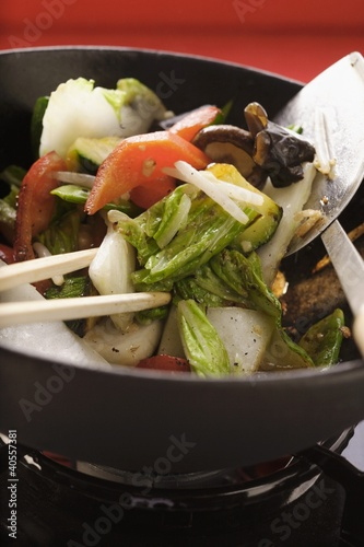 Asian vegetables with mushrooms in wok