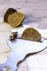 Black truffle with truffle slicer