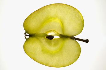 Slice of apple (sliced lengthwise), backlit