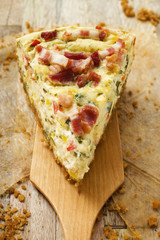 Piece of leek and bacon quiche on server