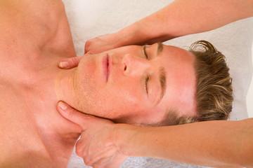 young man receives a neck massage