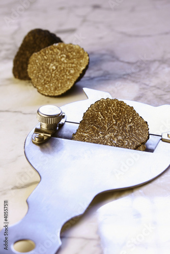 Black truffle with truffle slicer