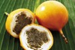 Granadillas (passion fruit), whole and halved