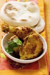 Spicy Tandoori chicken with flatbread (India)
