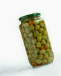 A jar of green olives stuffed with peppers
