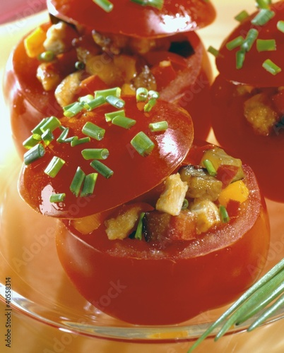 Tomatoes stuffed with aubergines and chicken