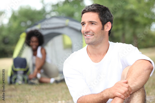 Couple in front of tent