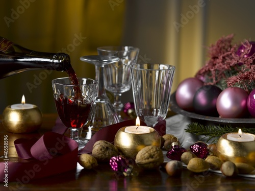 Table with Christmas decorations and red wine