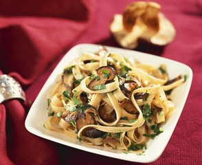 Ribbon pasta with mushrooms and parsley