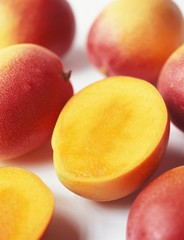 Mangos, one halved
