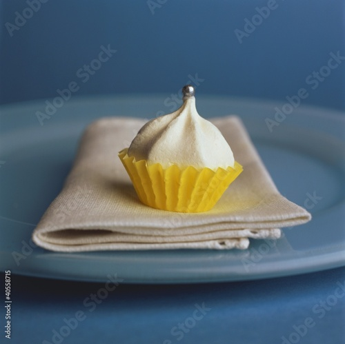Small meringue in yellow paper case