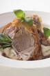 A slice of roast shoulder of lamb with crisp fat