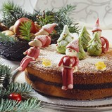 Poppy seed cake decorated with Christmassy marzipan figures