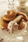 Biscuits (vanilla crescents, meringues) on glass stand