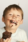 Boy eating a piece of chocolate cake