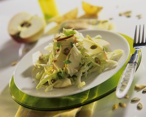 White cabbage and apple salad with pumpkin seeds