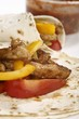 Fajitas filled with pork and peppers