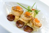Fried scallops with caviar, mashed potato and sausage