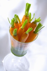 Caramelised carrots with herb sauce in a glass