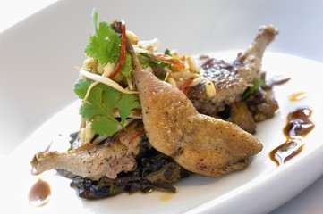 Roast quail with mushroom risotto and salad
