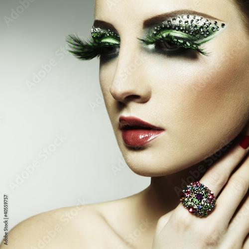 Fashion photo of a young woman with long eyelashes
