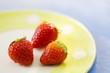 Three strawberries on plate