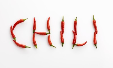 The word 'CHILI' written in red chillies