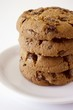 Four chocolate cookies in a pile