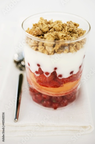 Layered dessert with fresh fruit, yoghurt and muesli