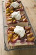 Three pieces of damson cake (Zwetschgendatschi) with cream on rack