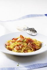 Spaghetti carbonara with salmon