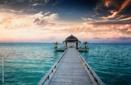 Fotobehang Zonsondergang Sunset / Sunrise Jetty at Maldives / Malediven