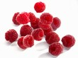 Raspberries falling onto a light surface