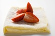 Crêpes with icing sugar and strawberries