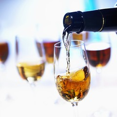 Pouring sherry into a glass