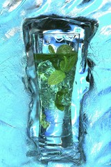 Mojito with fresh mint surrounded by ice