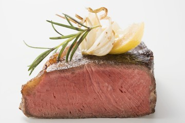 Beef steak with rosemary, garlic and wedge of lemon