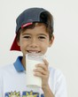 Boy holding a glass of milk