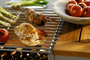 Chicken breast stuffed with cheese and bacon on barbecue