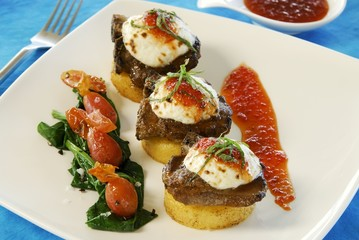 Potato cakes topped with buffalo medallions & goat's cheese