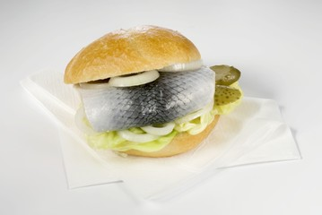 Herring roll with gherkin and onion