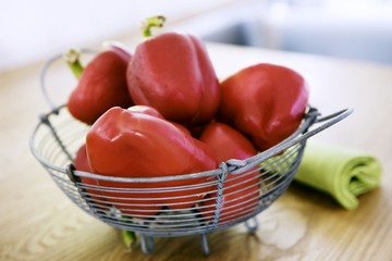 Red peppers in a wire basket