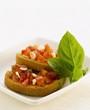 Two bruschetta with tomato salsa