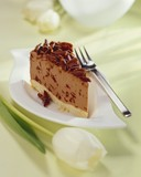 Piece of hazelnut chocolate cheesecake with grated chocolate
